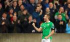 Niall McGinn celebrates opening the scoring against Estonia.