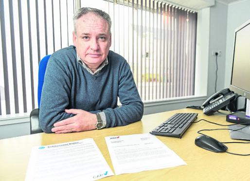 MSP Richard Lochhead in his office in Elgin, Moray.