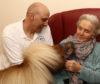 John Sangster with minature shetland Winston meets resident Margaret Campbell