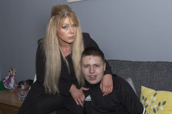 Wick mum Sarah Jane Scollay, with her son, Tyler, who is autistic.
