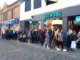 Eager locals and visitors queuing to be the first customers welcomed into BrewDog which is hoped will boost the town