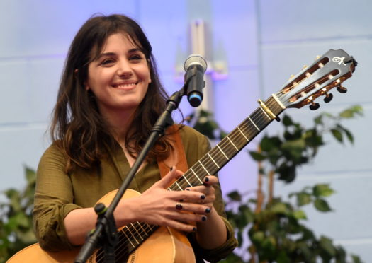 Katie Melua on the invitation of pupil, Madeleine Lenthall sings with the choir at Alford Community Campus, Alford.