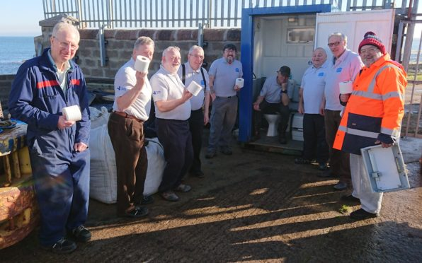 Members of Peterhead Mens Shed delighted they won't be using a portable toilet much longer