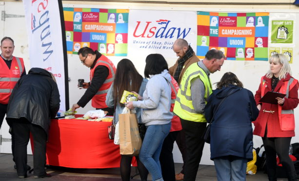 Shop workers from union Usdaw gather on Union Street