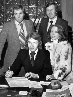 Steve Archibald signs the forms in 1978 which made him an Aberdeen player. Looking on are Clyde manager Craig  Brown, Dons' boss Billy McNeill and Archibald's wife Maureen.