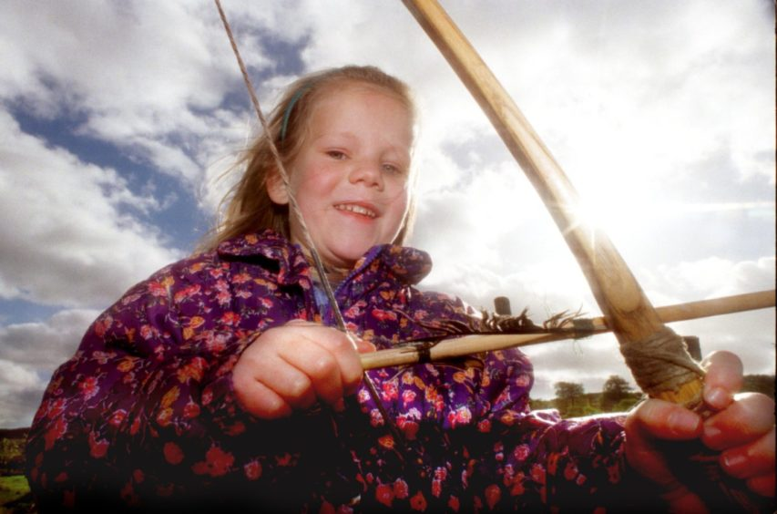 Kirsty Coombs 6 from Banchory takes a lesson in Longbow at Archaeolink.