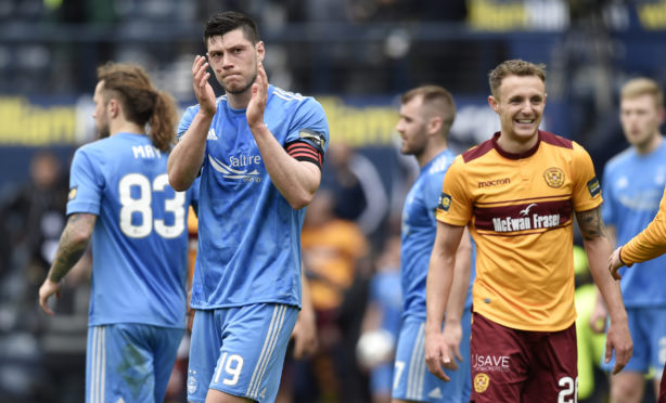 Scott McKenna captained Aberdeen for the first time in last year's semi-final against Motherwell.