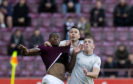 Andy Considine and Lewis Ferguson grapple with Uche Ikpeazu.