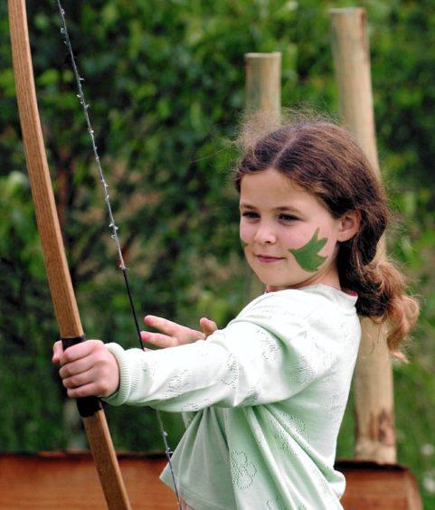 Ailsa Durden 8 from Queenscross tries her hand at archery.