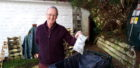 Councillor Allan Henderson wants people to take home their rubbish and put it in the bin.