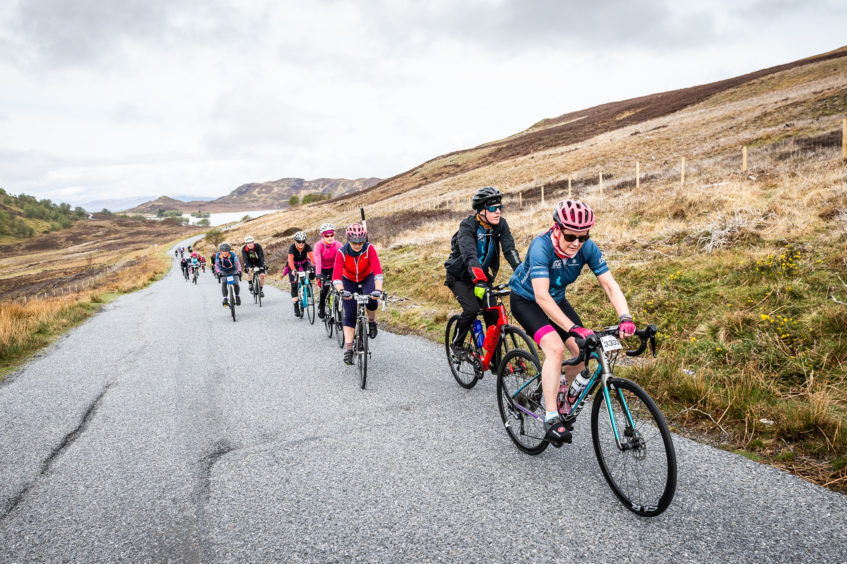 Cyclists on the final ascent of the King of the Mountain stage to the Suidhe viewpoint.