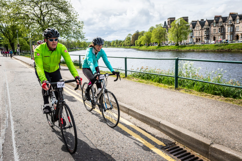 Enjoying the final moments as riders pass along the River Ness and into town.