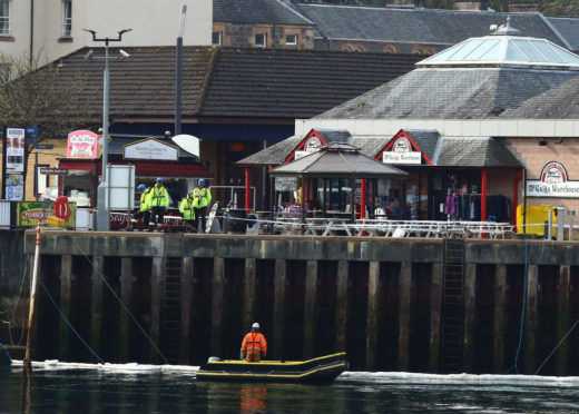 A cordon has been placed around a boat that has sunk in Oban Bay. photo Kevin McGlynn