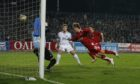 Darren Mackie heads in the decisive goal against Dnipro.