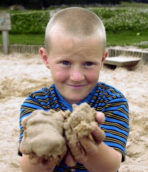 Left to right - Nathan Ross 7 has fun in the sand pit picture by Amanda Gordon