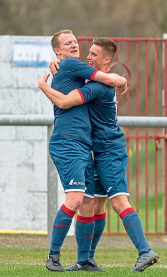 L 4 Turriff Ross Anderson gets a hug for opening the scoring.