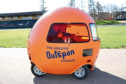 Andrew tries out the Outspan orange car at Grampian Motor Museum