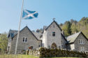 Picture by SANDY McCOOK   22nd April '19 Glenfeshie Estate, the Scottish home of Anders Holch Povlsen. A flag flies at half mast yesterday (Monday) at Glenfeshie Lodge on the estate to mark the tragedy in Sri Lanka.