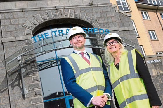 Gavin Currie, managing director of Bancon Construction (left), with Liz Hodge, chief executive of Aberdeen Science Centre (right), outside the old granite Tramsheds