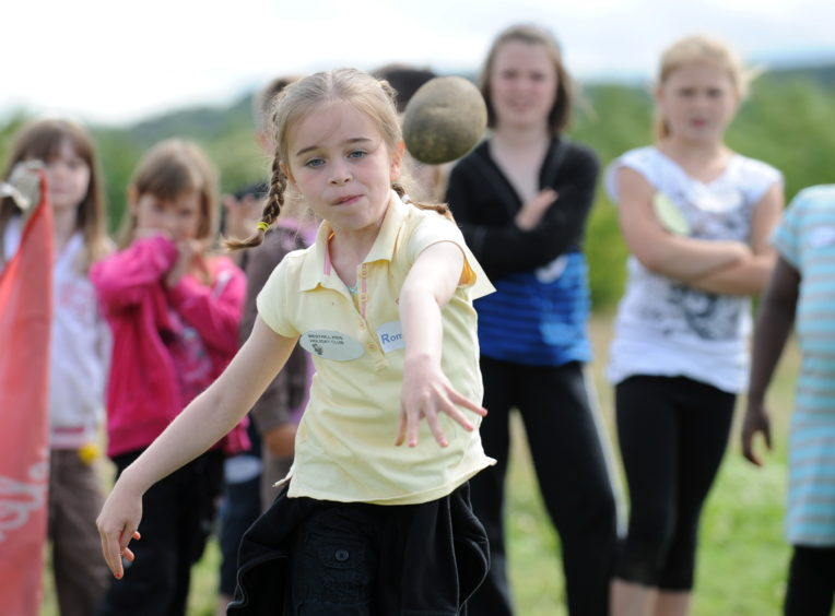 Taking part in the annual mini highland games at Archaeolink, Oyne is Katie McDougall from the Westhill Kids holiday club. .  Picture by Jim Irvine