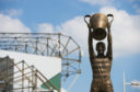 The statue of Billy McNeill holding the European Cup trophy at Celtic Park.