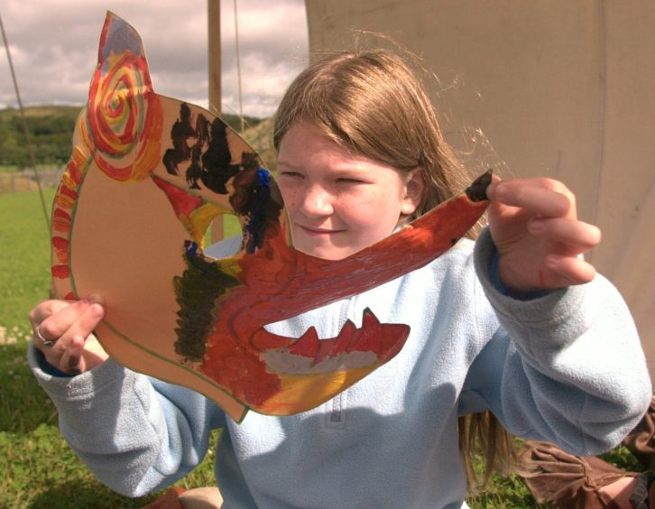Samantha Falconer 8 from Sheddocksley with the mask she made at the Iron Age farm picture by Amanda Gordon