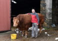 "Andy Duncan with his ""gentle giant"" bull on his farm in Keig."
