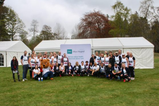 Staff and consultants from BMI Albyn Hospital, who took part in the Balmoral Run, accompanied by Aberdeen Cyrenian's Buddy the Bear and Vanessa Wilhelm of the charity