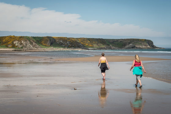 Walkers on the beach at Cullen.