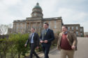 Moray MP Douglas Ross, Shadow Health Secretary Miles Briggs and Highlands and Islands MSP Jamie Halcro Johnston outside Dr Gray's Hospital.