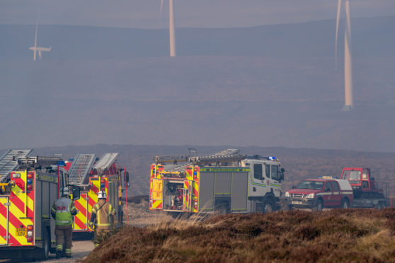 This is the scene of the Fire Units within Pauls Hill Wind Farm, Moray, Scotland on Sunday 14 April 2019. It is understood that there are 7 units in attendance, however, the Fire is some distance away to reach. Photographed by JASPERIMAGE ©