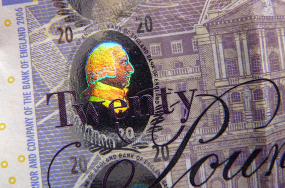 LONDON, ENGLAND - FEBRUARY 24:  A detail of the holographic foiling on a £20 banknote, featuring a profile of the economist Adam Smith, on February 24, 2016 in London, England. The next range of banknotes will be printed on polymer. The new £5 note will be issued in September 2016 and will feature Sir Winston Churchill, the £10 note will be issued in 2017 and the £20 note by 2020.  (Photo by Jim Dyson/Getty Images)