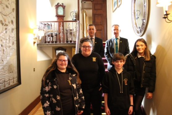 From left to right: Amy Ellis,  Libby Gordon,  Jonathan Cook,  Deryn Beattie.  In the background on the left is Kenny McMillan , General Manager of the Pittodrie House Hotel and on the right is Phil Gaiter , Rector, The Gordon Schools ,Huntly.