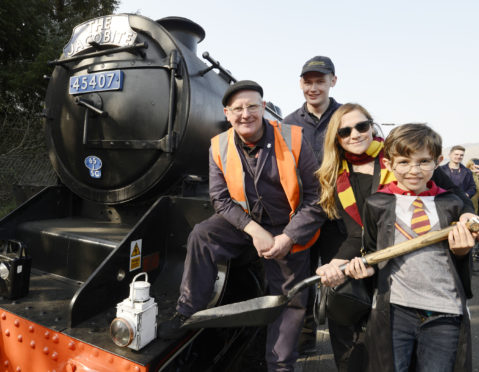 Lizeth Guerrero travelled from Mexico to take her nephew, Alex Galbraith for a trip on his favourite 'Harry Potter' steam train and was welcomed by Footplate crew Andy Simpkins (left) and Alex Johnston.