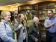 Ann Buchan, 94, visits the RAF Lossiemouth heritage centre with volunteer John Baxter and her daughter and granddaughter.