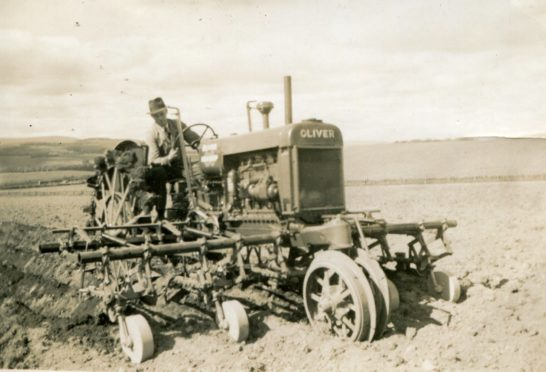 Working a field with an Oliver 80 Row Crop tractor