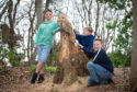 Picture by JASON HEDGES      Pictures show new wood sculptures created by Garry Shand and located in the 'Burn of Fochabers'   Picture: with Owl L2R - Isaac Mellor-Hedges, Calum Macpherson and Connal McGeoch  Pictures by Jason Hedges