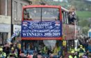 Ross County celebrated their winning of the Scottish Championship with a party in Victoria Park followed by an open top bus parade through Dingwall on Saturday afternoon to show off their silverware. Picture by Sandy McCook.