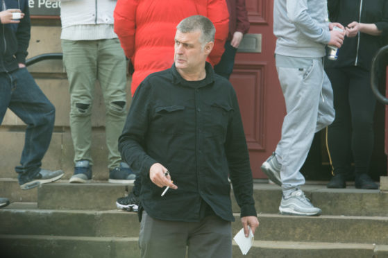Peter McPhail is pictured leaving Elgin Sheriff Court.