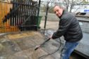 Rockfish owner James Pirie cleaning up the damage caused by vandals