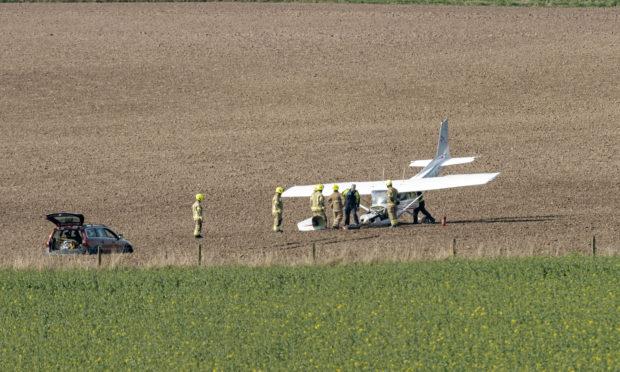 Light aircraft registration G-BKAZ seen crash landed at Newton of Ballunie Farm, Kettins, Blairgowrie.