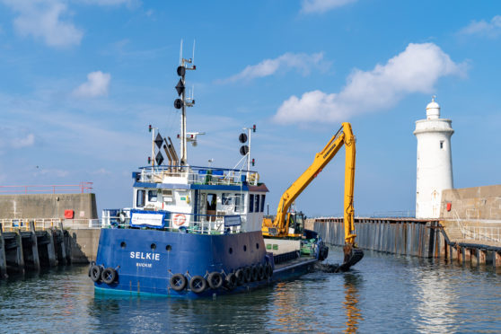 The Selkie dredging at Buckie Harbour.