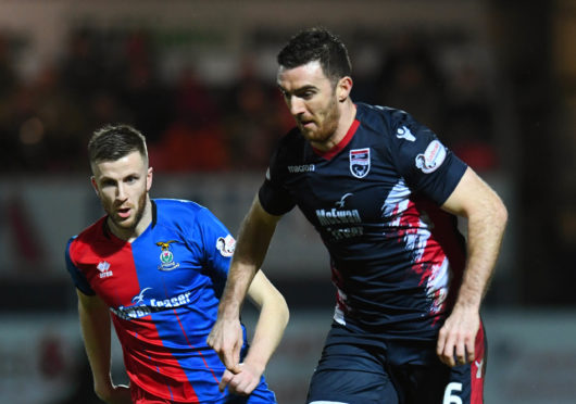 Ross County's Ross Draper (R) in action with Inverness CT's Liam Polworth.