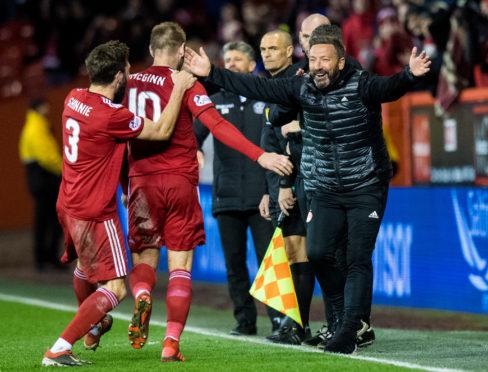 Aberdeen manager Derek McInnes celebrates with goalscorer Niall McGinn.