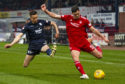 Aberdeen's Scott McKenna (R) in action with Dundee's Cameron Kerr.