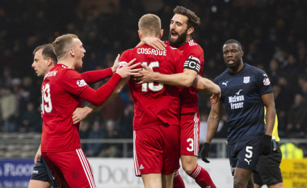 Aberdeen's Sam Cosgrove celebrates putting his side 1-0 up with Graeme Shinnie and Lewis Ferguson (L).