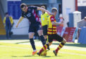 Ross County's Sean Kelly (L) competes with Partick Thistle's Blair Spittal.