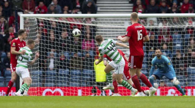 Celtic's James Forrest curls past Aberdeen goalkeeper Joe Lewis  to make it 1-0