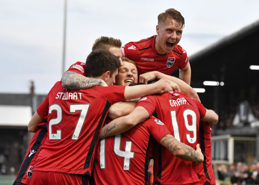 Brian Graham (19) is mobbed after second goal against Ayr.