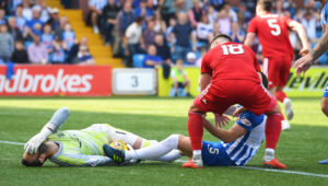 Kilmarnock's Kirk Broadfoot (right) challenges Aberdeen's Joe Lewis.
